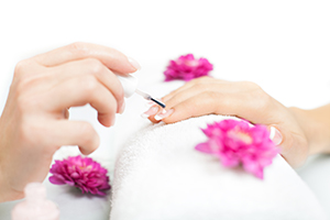 Beautiful female hands being manicured in a nail salon